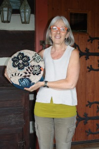 Susan L Feller with mixed media hassock