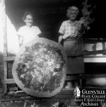 Blanche and Otha McDonald with rug, archival photo